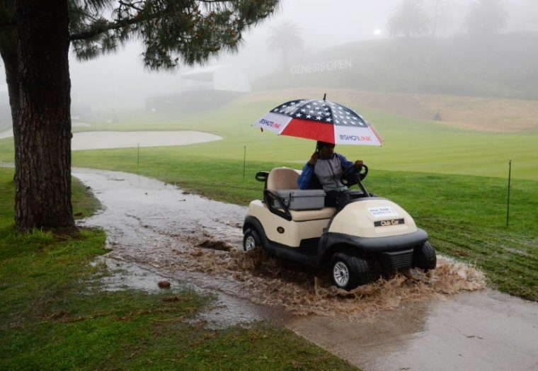 spieth shares clubhouse lead at rain