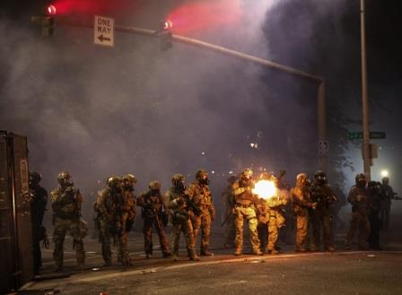 Federal officers fire tear gas shells again at Portland ...